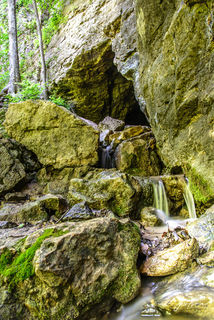 A small spring cascades from the mouth of a cave at Maquoketa Caves State Park in Jackson County, Iowa.