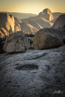 Sunset over Half Dome as seen from Olmstead Point in the high country of Yosemite National Park, California.