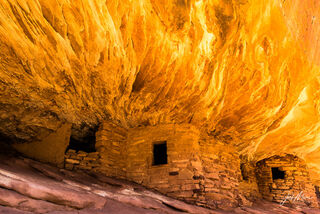 Sunlight illuminates a cliff over an ancient dwelling in Bears Ears National Monument to create the allusion of smoke and flames.