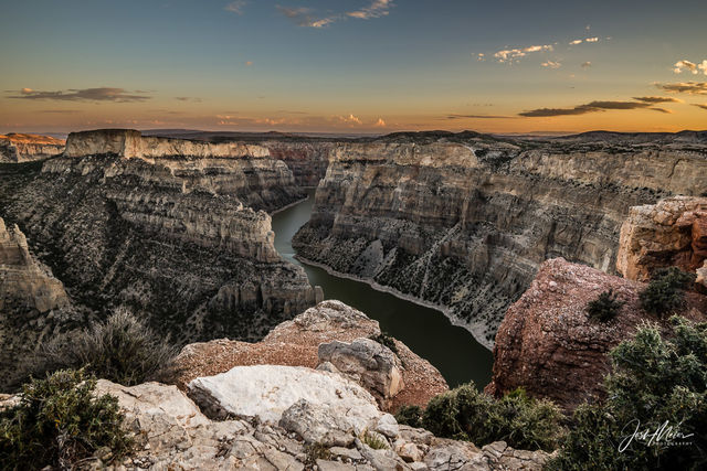 Soft light paints subtle striated hues to reveal chapters of geologic time as dusk falls on Wyoming's Bighorn Canyon.