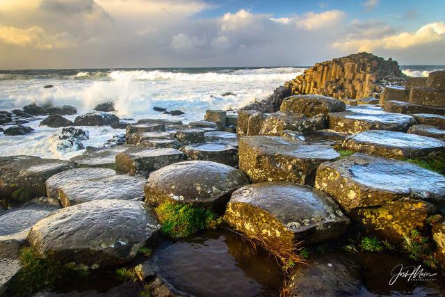 Basalt columns descend like stepping stones into the Irish Sea at Giant's Causeway, Northern Ireland.