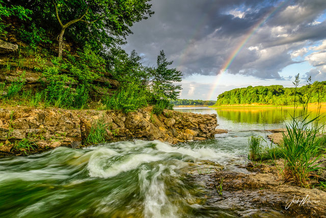 A rainbow appears over the Coralville Reservoir as seen from the spillway at Iowa's Lake Macbride State Park.