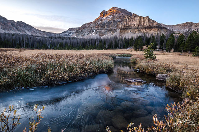 Alpenglow lights the summit of Ostler Peak on a frosty autumn morning, as seen from Amethyst Basin in the High Uintas Wilderness.