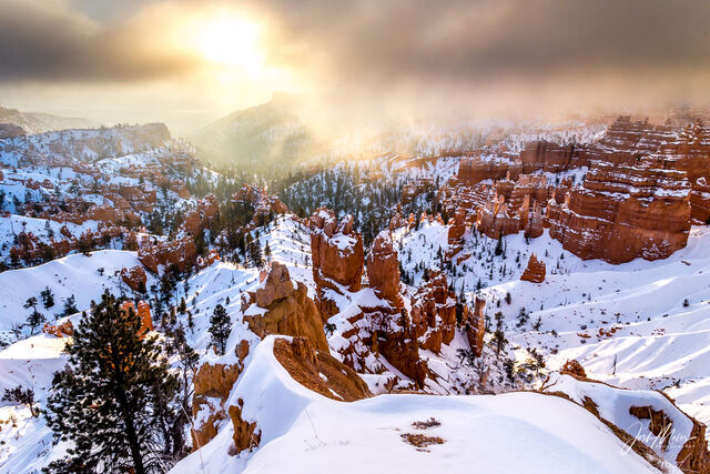 Sunrise over snow-covered hoodoos in Bryce Canyon National Park, Utah.