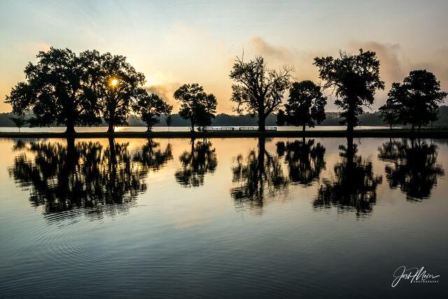 Daybreak over Boyscout Island at Lake Manawa State Park near Council Bluffs, Iowa.