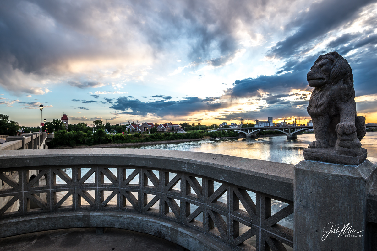 """The 16th Avenue Bridge, sometimes known locally as """"Lions Bridge"""" for the guardian statues perched on its railing, connects historic..."""