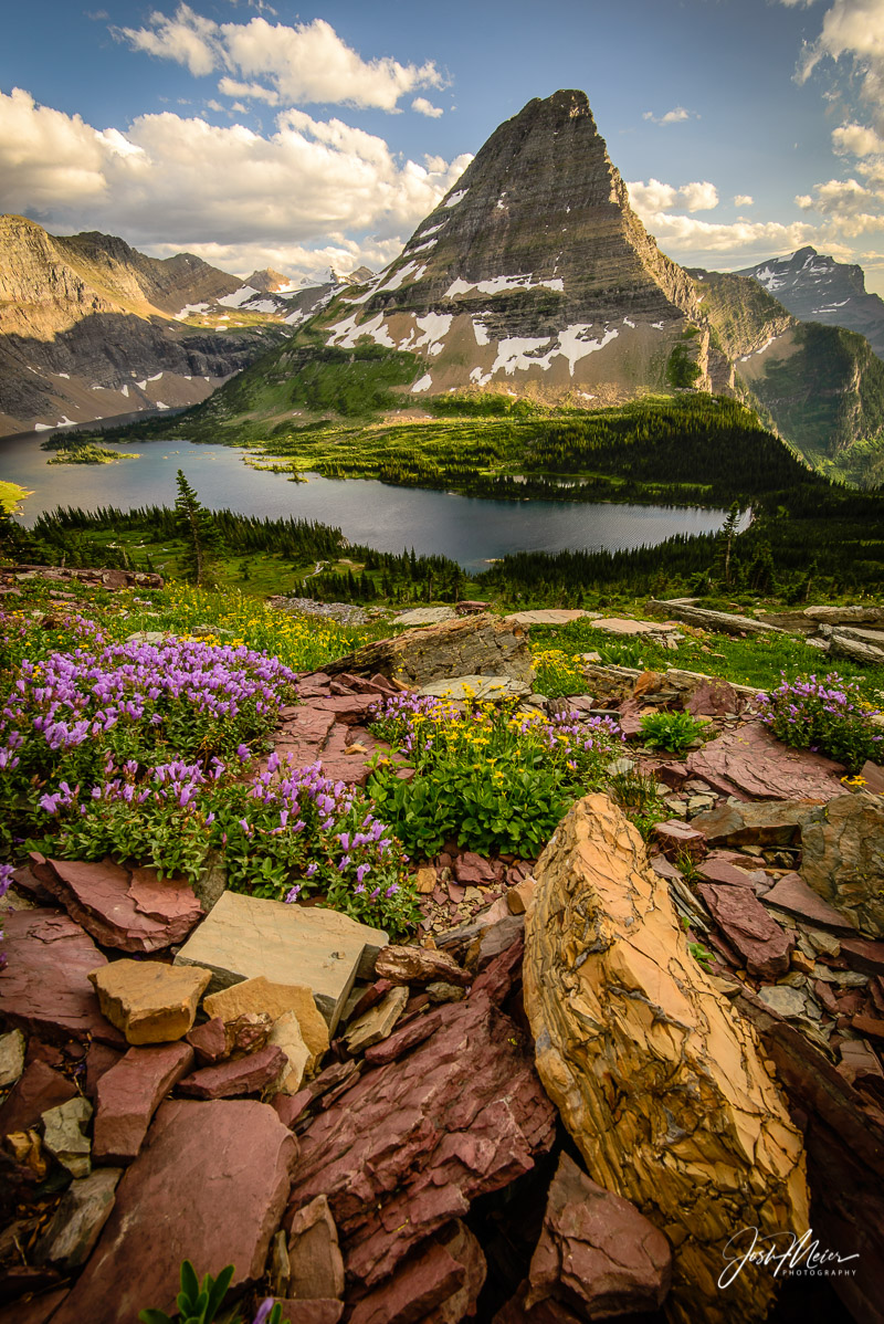 Golden hour glow on Bearcat Mountain, rising over Hidden Lake in Glacier National Park, Montana.