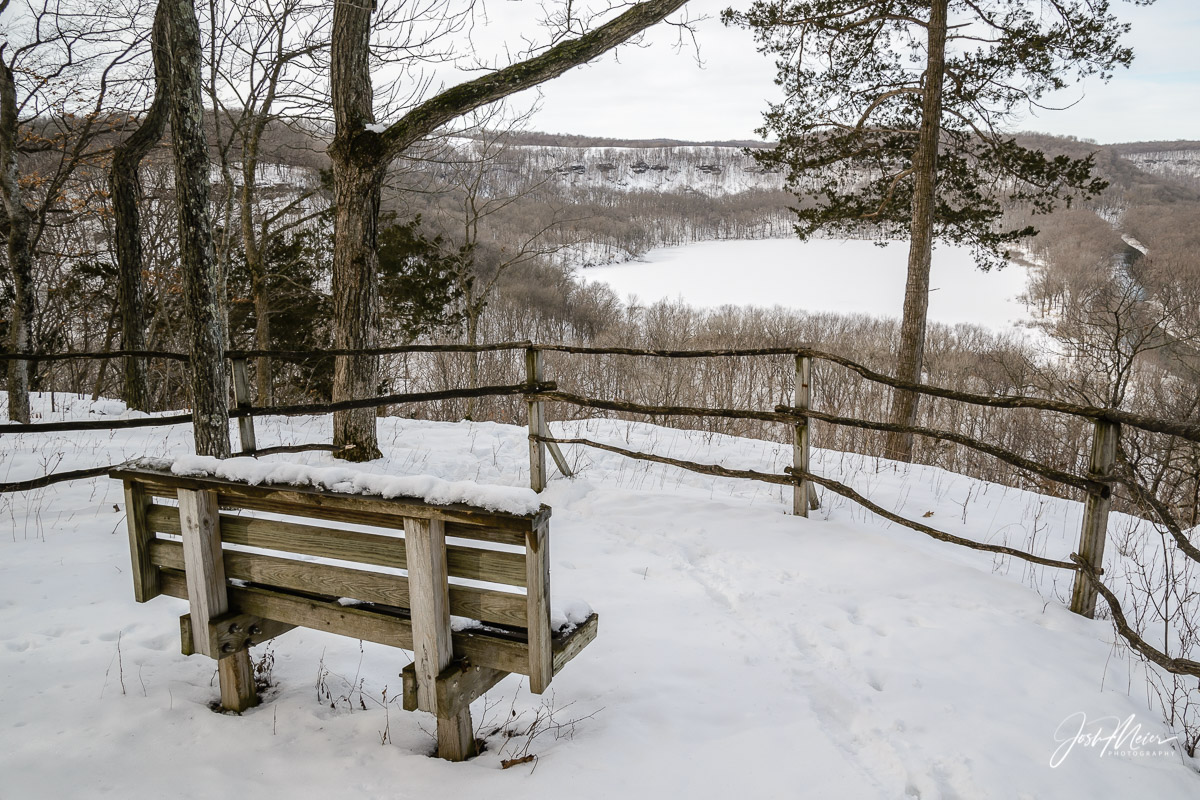A peaceful overlook of Founders Pond in Effigy Mounds National Monument. Seeing this quiet snow covered bench in the depth...