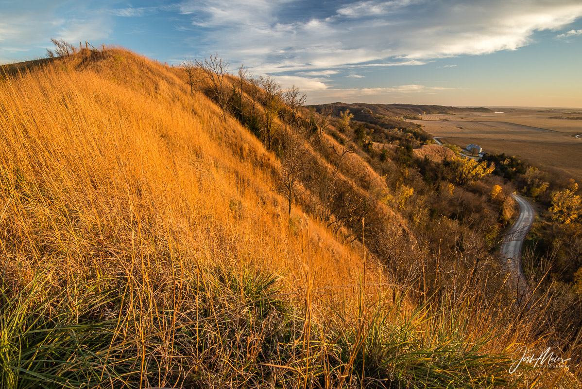 Murray Hill rises over a quiet rural highway in the Loess Hills of Harrison County, Iowa.