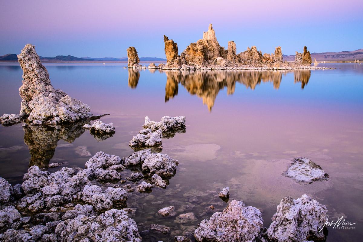 Pink and purple tones of sunset over Shipwreck Tufa in Mono Lake, California.