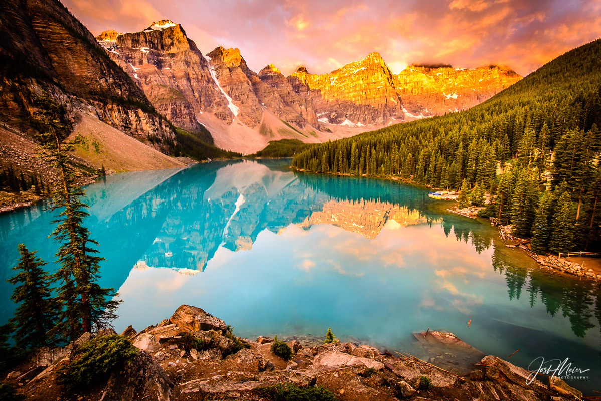 Gorgeous sunrise colors in passing storm clouds over Moraine Lake in Banff National Park, Alberta.