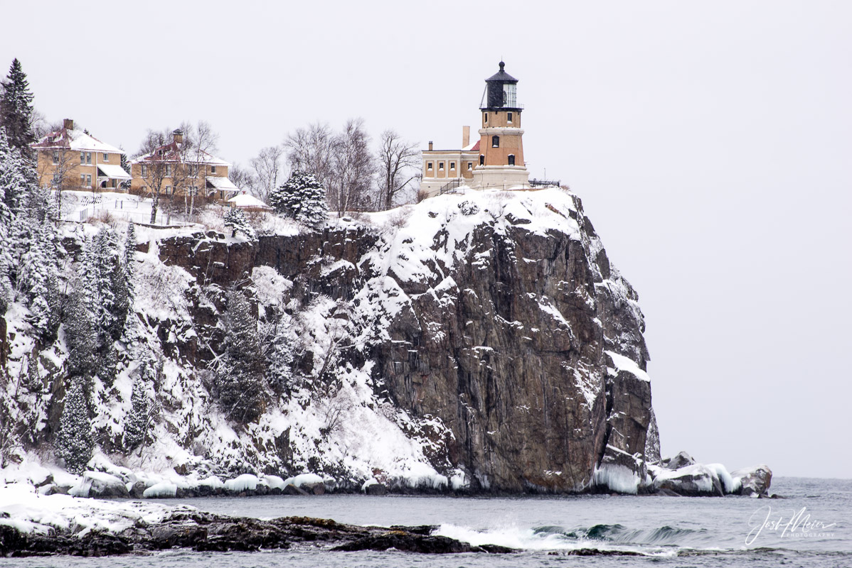 Split Rock Lighthouse over the rocky shoreline of Lake Superior.
