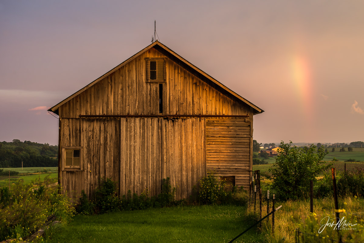 An early morning rainbow in rural Cedar County, Iowa. The weathered barn wood of this old corn crib has seen a lot...
