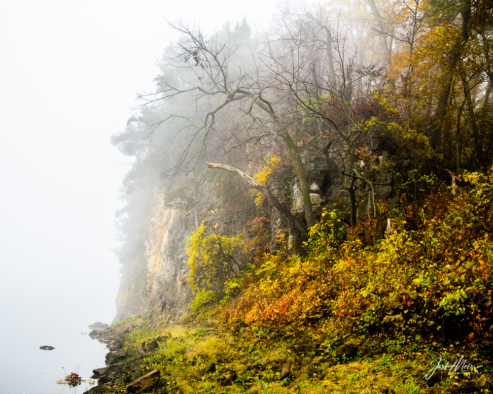 Autumn foliage on a foggy morning along the Cedar River in Iowa's Palisades-Kepler State Park. Palisades (located between Cedar...