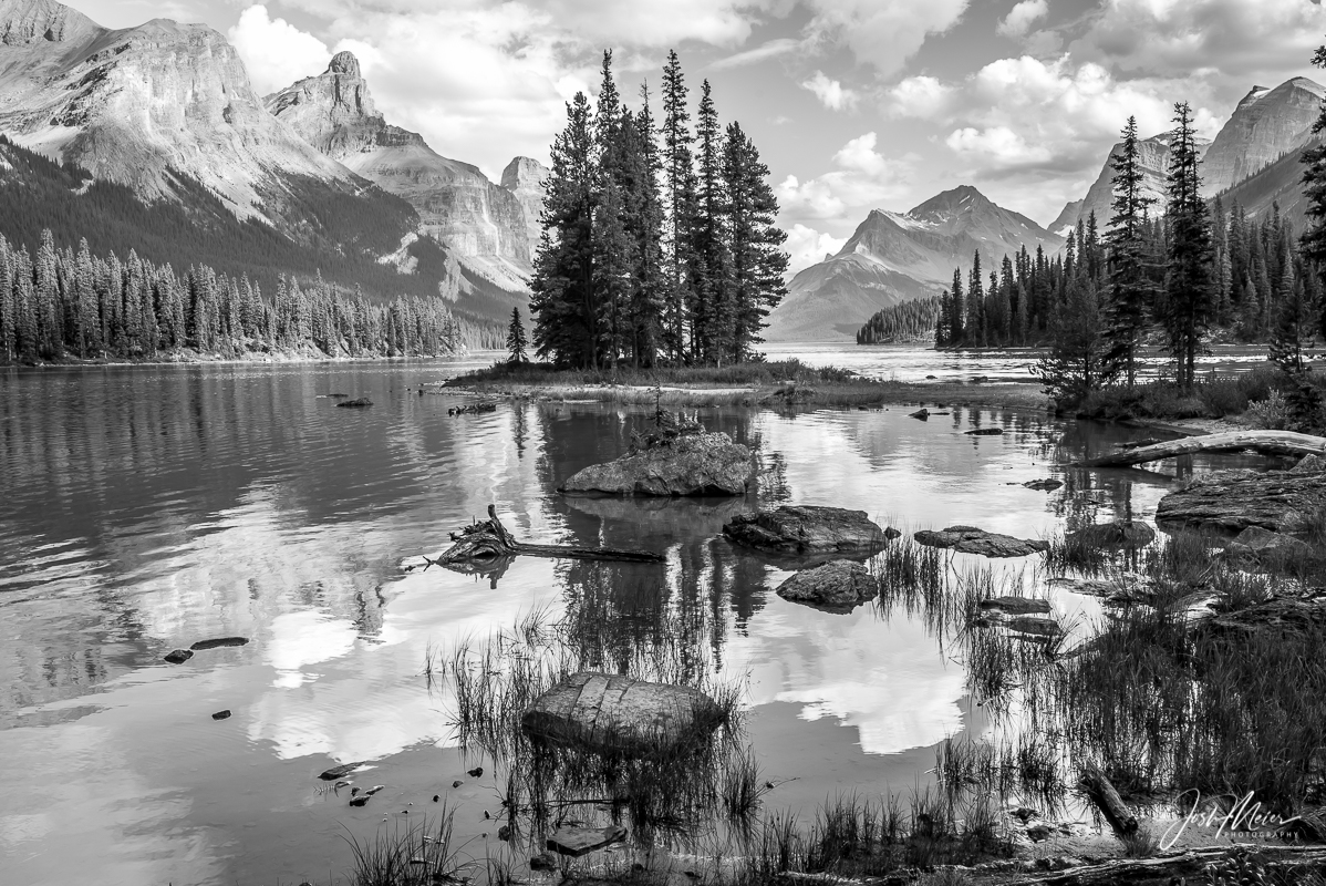 An icon of the Canadian Rockies, Spirit Island sits amidst a backdrop of picturesque peaks in Maligne Lake of Jasper National...